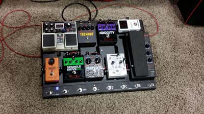 Let me draw your attention to the little row of buttons at the bottom... My friends at Voodoo Labs are coming out with this great loop switcher that actually attaches to the bottom of one of their new pedalboards (see below.) It is GENIUS!